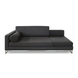18KARAT - Chi Chaise, Black, Right - Relax into the generously proportioned Chi Chaise. This Peter Cardew design adds a sense of understated luxury to any room with its stainless steel legs and geometric bolster cushion.