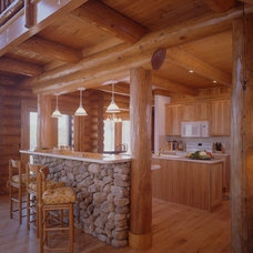 Traditional Kitchen by Rocky Mountain Log Homes