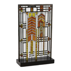 """YTC Frank Lloyd Wright Collection - Frank Lloyd Wright Autumn Sumac Stained Glass - The Frank Lloyd Wright Autumn Sumac Stained Glass is adapted from a window in the Susan Lawrence Dana House in Springfield, Illinois, featured Mr. Wright's repeated design of the native prairie Sumac plant, in an abstract form. The rich amber and green colors in the glass give the piece an autumnal feeling. The original window was one of a pair located in the reception hall of the house. This stained glass panel has been developed in association with the Frank Lloyd Wright Foundation. On this glass panel, enamel colors are individually applied to a single sheet of glass which is then kiln fired to permanently fuse the enamels to the glass. The glass panel is then framed with a metal came and includes a hanging chain and wood stand for desk or table display. Ht: 10"""". W: 6.25""""."""