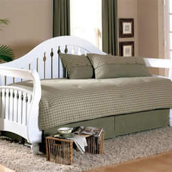 Leggett/Platt Fashion Bed - Fraser Daybed in Frost Finish (w/o Link Sprin - Choose Type: w/o Link Spring, Front Panel and RolloutBoth dramatic and elegant with keyhole patterned slats, this stunning daybed will be a spirited way to add extra seating and sleeping space to any decor. Highlighted by graceful curves and bold arches, the daybed has a poplar and MDF frame and is finished in frost white. Curved camel back and the arms curve out. Wood slats set one inch apart with a keyhole pattern carved in the center slats of the back and all the slats of the arms. The front of the arms bow out at the bottom and end in delicately carved feet. Made of Poplar wood and MDF. Suitable for both seating and sleeping. 41.125 in. W x 89.375 in. D x 49.5 in. H (94 lbs.)