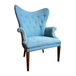 """Used Blue Mid-century Modern Wingback Chair - A Mid-century Modern Wingback chair in blue dotted fabric. Tops of the chair come together in a beautiful sloping curve. A gorgeous accent piece that would complement your Contemporary or Modern styled home. Fabric is in great condition, although there is a small rip (1"""") in the seat of the chair, plus some wear and scuffs around the legs."""
