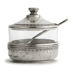 Anna Caffe Sugar with Spoon - A pewter-clad glass jar with a conical lid, the Anna Caffe Sugar with Spoon was designed as a companion to a transitional tea set, but the look is perfect for other everyday purposes in the kitchen or on the vanity! Appealing and artisanal, this cylindrical dish comes with a matching spoon whose detailing picks up the circular design stamped on the edges of the pewter accents.