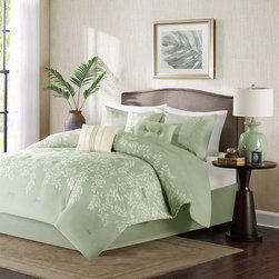 Madison Park - Madison Park Flora 7 Piece Comforter Set - Give your bedroom a luxurious retreat with the Flora collection. The comforter and sham features a simple leaf motif in taupe and ivory that is printed on the sage green ground. The comforter and sham reverses to a solide sage green color. The set includes a tailored solid sage green bed skirt. The set includes three decorative pillows to complete the whole look. Comf & sham face: 100% polyester microfiber 75gsm print with embroidery, reverse: polyester microfiber 75gsm solid. Comforter with 250gsm poly fill. Pillows: 100% polyester cover with poly fill; Bedskirt: non woven platform and micro fiber drop