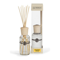 Pineapple Ginger Home Diffuser - 8 oz. - Like being transported to a pineapple farm in the rich lush tropical island of Hawaii, the Pineapple Ginger soy diffuser's deliciously sweet fragrance fills any room with a light tropical feeling reminiscent of a warm day in Summer. With just a touch of spicy ginger as an additional scent note, this fragrance will envelope the room in a beautiful scent without being overpowering.