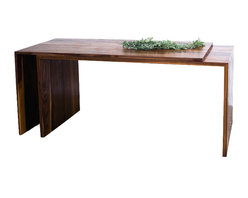2131 - Extending Walnut Dining Table - This piece is the contemporary solution to the drop leaf table for smaller tables, or for people who need a versatile table top. This table is made of two overlapping solid pieces of walnut, each cleanly assembled with mitered joints. The two pieces overlap, fitting tightly for a minimalist five foot long table. When the top is pulled away from the base, the table may go from being five feet long to ten feet long, doubling the number of seats. If the top is pulled at an angle, you may create a beautiful, minimalist and functional work space with two surfaces.