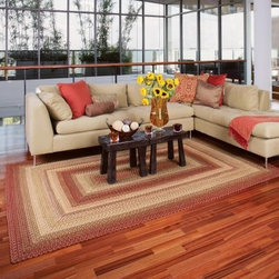 Homespice Decor Out-Durable Indoor/Outdoor Braided Area Rug - Barcelona - With its lively multi-colored design the Homespice Decor Out-Durable Indoor/Outdoor Braided Rug - Barcelona captures the splendor of Spain. This braided rug weaves burgundy dark and olive greens gold and cream for an exciting energetic texture. Stylish enough for indoors and durable enough for outdoors this rug is made with stain-resistant DuPont olefin material. You'll appreciate this rug's natural shades and comfortable feel under your feet. It will stay comfortable too because it's reversible. Recommended cleaning includes vacuuming regularly and spot-cleaning with mild detergent or spraying with a garden hose and drying flat. Available in a variety of shapes and sizes this rug is made in India by Homespice Decor. One-year limited warranty.Sizes offered in this rug:Following are all sizes for this rug. Please note that some may be currently unavailable due to inventory. Also please note that rug sizes may vary by up to 4 inches in dimensions listed.Dimensions:2 x 3 ft.2.3 x 4 ft.3 x 5 ft.4 x 6 ft.5 x 8 ft.6 x 9 ft. 8 x 10 ft.2.6 x 6 ft. Rectangle Runner2.6 x 9 ft. Rectangle Runner2 x 3 ft. Oval2.3 x 4 ft. Oval3 x 5 ft. Oval4 x 6 ft. Oval5 x 8 ft. Oval6 x 9 ft. Oval8 x 10 ft. Oval2.6 x 6 ft. Oval Runner2.6 x 9 ft. Oval Runner7.6 ft. RoundAbout Homespice Decor RugsProducing quality homemade products since 1998 Homespice Decor has become an industry leader in braided rugs (outdoor indoor wool cotton) and has expanded its line to include penny rugs rag rugs and its newest - Supernova rugs - which feature a swirling star braid design. Formerly known as J Quilts Company Homespice Decor shifted its focus from quilts to rugs pouring itself into the intricate details of braided rug craftsmanship. Homespice Decor is committed to providing affordable braided rugs of the highest quality in an abundance of sizes and styles.