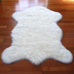 Snowy White Polar Bear Pelt - Nothing says nursery like a snow white, fluffy sheepskin rug. We used something similar in my son's nursery over a dark hardwood floor for a beautiful contrast. It's so sweet, and, as a bonus, feels divine under bare feet.