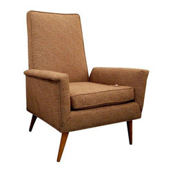 Pre-owned Mid-Century Modern Upholstered Lounge Chair - Lounge like Mad Men (and Women) in this Mid-Century vintage lounge chair. Its wood tapered legs add to the streamlined look characteristic of the atomic era.