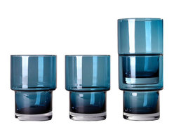 Stackable Glasses, Blue, Set of 4 - To satisfy all the sipping needs, this set of four stack glasses is created, a reliable choice with conscientious curves. Featuring everyday-sturdy construction and a rounded lip, each one is mouth blown and stacks neatly to save you cabinet space. They're smart, they're stylish—so you don't need to think before you drink. Just add water (or juice, or whatever satisfies your thirst).