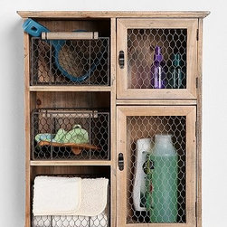 Reclaimed Wood Storage Unit - When I first moved into my home, the laundry had zero storage. The wall-mounted unit I installed (admittedly not as cool as this one) made cleaning so much easier with everything in arm's reach.