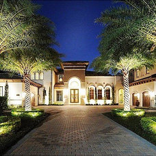 Mediterranean Exterior by Renderings and Interiors