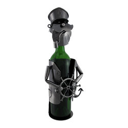 Sailing Captain at the Helm Metal Art Wine Bottle Display - Give your wine bottles some personality! This unique piece of home decor would make a great housewarming gift. The remarkable figure is formed in the likeness of a captain standing at the helm of his ship with a pipe in his mouth and an anchor over his shoulder. Bottles stand inside the body and are topped with the head piece, turning the neck of the bottle into that of the captain. The head piece is attached to the body by a chain to avoid misplacement. Crafted from metal, the display measures 14 inches tall, 6 inches wide, and 4 inches deep. It makes a great conversation piece, and is sure to be admired. NOTE: All measurements include the wine bottle, but the bottle is not included with purchase.