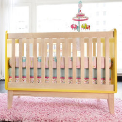 Zutano - Zutano Tivoli Convertible Crib - 04573-511 - Shop for Cribs from Hayneedle.com! The Zutano Tivoli Convertible Crib is a sleek and modern crib that would make a perfect addition to your baby's nursery for years to come. Featuring gorgeous two-tone modern styling in your choice of safe non-toxic finishes this crib is a real show-stopper. It's constructed of quality wood and features stationary sides for added safety and an adjustable mattress platform that adjusts as your baby develops. This crib will convert to a toddler bed (guard rail is included) and can be used as a daybed when you remove the guard rail. JPMA certified.About ZutanoThrough color whimsy and unique versatility Zutano draws inspiration from the children of the world and is committed to celebrating the diversity of all children. They create exceptional innovative and versatile products for babies and children from baby clothing crib bedding nursery furniture gear booties hats and decor. Located in the quiet hills of Cabot Vermont Zutano is inspired to continually identify ways to acknowledge the unique character and joy of each little girl and boy.