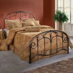 Hillsdale Jacqueline Metal Bed - The sensual curves and intricate embellishments of the Jacqueline Bed offer a classic style. Rich Old Brown finish paired with curved headboard and footboard create a beautiful flow and rich feel to the design. The bed has foundry-poured castings and fully welded heavy-gauge metal for durability. Various sizes and configurations including a headboard-only option based on availability. Dimensions: Queen/Full: Headboard - 61L x 55H inches Footboard - 61L x 34H inches (Queen can adapt to full size beds) King: Headboard - 77L x 55H inches Footboard - 77L x 34H inches About Hillsdale Furniture:Located in Louisville KY Hillsdale Furniture is a leader in top quality affordable bedroom furniture. Since 1994 Hillsdale has combined the talents of nationally recognized designers and globally accredited factories to bring you furniture styling and design from around the globe. Hillsdale combines the best in finishes materials and designs to bring both beauty and value with every piece. The combination of top quality metal wood stone and leather has given Hillsdale the reputation for leading-edge styling and concepts.