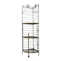 """Pre-owned Vintage French Baker's Rack - A 19th Century wrought iron and brass baker's rack from a french boulangerie. It features solid brass fittings and a crowned with a wheat sheaf motif. Details include shelf supports with rosettes, and brass finials. Beautiful grill work on the shelves indicative to the """"Belle Epoque"""" era. This is a rare corner piece that will add a provincial touch to your kitchen or dining area.     Note from the seller: """"If you are considering this I would recommend mounting it to a wall for the most stability."""""""