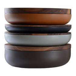 When Objects Work - VVD Pottery, Walnut - Belgian architect Vincent Van Duysen's collection of pottery epitomizes his minimalist aesthetic, use of natural materials and subtle color.  Though each piece is powerful in isolation, the collection is conceived as an entity: an evocation of the shelves of stacked vessels in a potter's studio. Read as a series, the differences of scale and color create powerful rhythms and modulations expressed in the subtle but intense palette of a northern European sky. Each piece is composed of two elements: an earthenware container and a wooden plate. Whilst the angle of curve and smooth profile of each pot are fixed, the diameter and the height of the vessels vary. These shifts in scale determine whether the container is a bowl or a platter. The thickness of the wooden plates, which serve as both cover and plinth, are also variable.