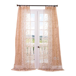 Exclusive Fabrics & Furnishings, LLC - Bella Gold Embroidered Sheer Curtain - Take advantage of this decorating opportunity and upgrade your window treatments with these embroidered gold curtains. These tasteful, scrollwork-patterned sheer drapes add instant elegance to any room you choose.