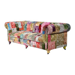 Bensington Velvet Boheme Sofa - A modern-day tribute to the historic patchwork design, the Boheme collection incorporates a sumptuous myriad of hand-dyed and printed vintage velvet fabrics, independently cut and pieced together into a patchwork design of over 30 colours. Upholstered on a range of classic sofas and easy chairs, the collection is a playful reinterpretation of vintage furniture, and its handcrafted production process ensures that no two pieces are the same. Available in a variety of colourways, each creation evokes a powerful, unique statement.