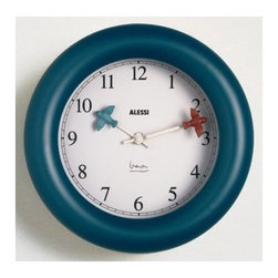 """Alessi - Michael Graves Kitchen Wall Clock - Add a unique touch to your kitchen walls with this Kitchen Wall Clock! Keep an eye on your food with this clock with unique hands! Features: -Wall clock. -Quartz movement. -Handwash recommended. Dimensions: -1"""" H x 1"""" W x 3.6"""" D."""