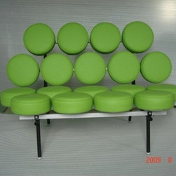 Pop Art Sofa - Our Pop Art Sofa is one of the first pieces to come out of the mod era of furniture history. With 18 individual cushions mounted on transverse braces in the seat and back, this piece is fun and incredibly comfortable at the same time. Available in Black, White, Green or Red Genuine Italian Leather.