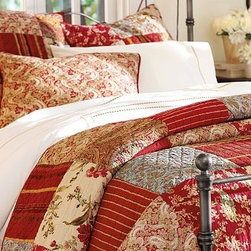 Georgia Patchwork Quilt, Twin, Red - Our vibrant mix of florals and yarn-dyed stripes is pieced and stitched entirely by hand. Our pure cotton quilt is perfect for mild nights.Pure cotton.Yarn dyed for lasting color.Reverses to solid red cotton sheeting.Sham has a tie closure; insert sold separately.Machine wash.Catalog / Internet only.Imported.