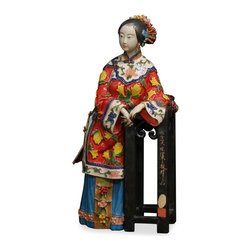 China Furniture and Arts - Chinese Porcelain Doll - With vivid facial expression and body gesture, this porcelain figurine depicts a young lady in early Qing (1644) costume resting against a pedestal.