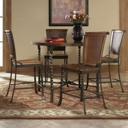 Riverside Medley 5 Piece Gathering Height Table Set - Penny Patina - Unique design elements and attractive finishes make The Medley 5 Piece Gathering Height Table Set an excellent selection for your dining area. The table features a copper marquetry tabletop and four twisted-metal legs conjoined at the uniquely designed interlocking metal cross-brace. Base levelers included for the table which seats up to four people. A pair of elegant counter stools featuring a lightly distressed Camden finish over the woven raffia chair back and Mindi-veneer seat complete this dining set. The metal frame of the stool is finished in wildwood taupe and the twisted front legs add elegance. Seat height is 24 inches. Assembly required. About Riverside FurnitureThe Arkansas River Valley is home to majestic forests ruggedly beautiful mountains gurgling brooks and swiftly flowing rivers. It is also home to Riverside Furniture Corporation. Riverside has been growing for more than half a century. The company's founder Herman Udouj opened the doors to his first factory in 1946 and along with 12 employees he began making hand-crafted furniture for the post-World War II Baby Boom era. Since then three generations of Americans have furnished their homes and offices with Riverside's wide range of furniture products. Riverside strives to be trusted for quality products that are an affordable value. It's just that simple.
