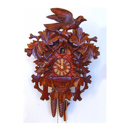 Schneider Cuckoo Clocks - 1-Day 10.6 in. Carved Cuckoo Clock in Honey Finish - Carved style. 1-day rack strike movement. Extra deep, very detailed carving of birds and flowers. Casing with structure at both sides. Wooden cuckoo, dial and hands. Shut-off lever on left side of case silences strike, call and music. Made from wood. Made in Germany. 10.6 in. W x 6.3 in. D x 13.8 in. H (4.6 lbs.). Care Instructions