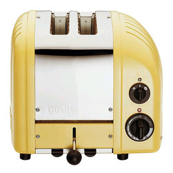 Dualit 2-Slice Toaster - Morning toast never looked or tasted this good! This French appliance just went up a notch in my book when it dipped itself in yellow.