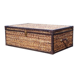 "Lanai Wicker Trunk Coffee Table 50"" X 30"" - Organic simplicity. Handwoven with twisted banana leaf hand-crafted of mahogany and mango wood and are reinforced at the corners with Leather and nailhead detail. This sophisticated piece echoes the peace and calm of a seaside escape. The truly natural look adds incredible depth and texture to your room and creates a neutral color palette perfect for building a room around."