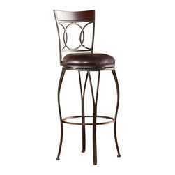 Holly and Martin - Granada Swivel Bar Stool - Add classic style and contemporary convenience to your home. The cast circles and curved legs of this bar stool create a sleek and sophisticated look. A powder-coated, dark champagne finish and durable steel frame deliver lasting quality. It features bar height seating, a cozy foam seat covered in rich dark brown vinyl, and a backrest accent in a rich walnut finish bentwood. A full 360 degree swivel and footrest ring provide comfort and ease. The curvaceous form and attractive finish coordinate with traditional to contemporary decor styles. Ideal for the kitchen, breakfast nook, bar, or dining area. Please note: Our photos are as accurate as possible, but color discrepancies may occur between the product and your monitor. The handcrafted touch of artisan skill also creates variations in color, size, and design; slight differences should be expected.