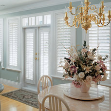 Traditional Living Room by Sunburst Shutters & Window Fashions - New England