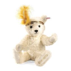"""Steiff - Steiff Charleston Teddy Bear - We're bringing back the Roaring 20's with our Charleston Bear, based on the dance craze of the era which spread from the U.S. around the world. The writer of the famous Charleston song said he first was inspired to write the hit when he heard Charleston, South Carolina dock workers singing. Steiff was inspired by fashions of the """"flappers"""" of the period, with their distinctive headpieces, fringed dresses, and dancing shoes. Our version of the """"Charleston Teddy"""" wears a sequined headband of gold accented with a golden yellow feather. Naturally, Steiff Charleston Bear is musical – wind her up and she plays a few bars of the """"Charleston"""" song. Made of wavy white mohair, the Charleston Bear is sure to sing its way into a place in your collection. Commemorating the 90th anniversary of the Charleston's rise to popularity."""
