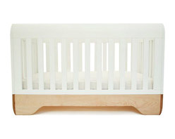 """Kalon Studios - Kalon Studios Echo Crib - Kalon Studios designs nursery furniture with a focus on contemporary form, innovative style and sustainability. The maple and white Echo crib balances bold and sophisticated elements with rounded surfaces and exposed hardware. A distinctly modern yet practical look, this hardwood baby furnishing features two adjustable mattress heights and optional conversion to a platform toddler bed (kit not required). Optional side safety rails available. Made in the USA from FSC certified domestic maple with a non-toxic finish and water-based, low VOC, 100% HAPs-free paint. Some assembly required. 54.5""""W x 30""""D x 33""""H. Choose optional toddler side rail kit. Fits standard crib mattress (not included). Conforms to ASTM, CPSC and Health Canada regulations. Glue contains zero formaldehyde and exceeds European E1 and California emission standards by 3 times."""
