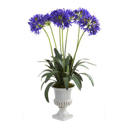 Covered In Style Inc - African Lily w/Urn - If your green thumb is more black than green, consider this African Lily. You can never overwater or underfeed this lifelike plant. There's no messy potting soil to deal with, either. And it comes with its own urn. Could you possible ask for more?