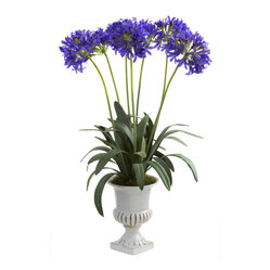 Covered In Style Inc - African Lily with Urn - If your green thumb is more black than green, consider this African Lily. You can never overwater or underfeed this lifelike plant. There's no messy potting soil to deal with, either. And it comes with its own urn. Could you possible ask for more?