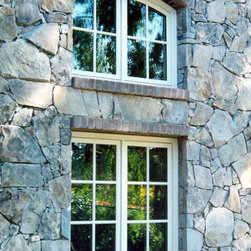 English Country Cottage - Window with stone and brick work