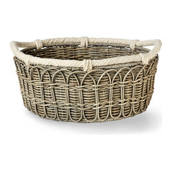 Large Wicker Basket - A hand-woven market basket presents produce or fresh bread in elegant provincial style on your table or gives an ephemeral attraction to casual, seasonal arrangements on the coffee table. This Large Wicker Basket is edged in ivory cotton rope to enhance the nostalgic appeal of its neutral palette; a woven chain in its sides gives it charming handmade presence.