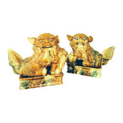 """Pre-owned Antique Foo Dogs - A Pair - This pair of antique good dogs have really gorgeous glazing. They are large, standing at 13"""" high and 14"""" wide at the largest point. The male, as is traditional, has his foot on a ball. The female (which makes this pair unique and made me totally fall in love) is holding a baby. This pair is so distinctive and would never be mistaken as a reproduction. These are the """"real McCoy"""" and they are to die for!!"""