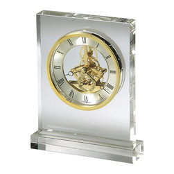 Howard Miller - Prestige Table Top Clock w Glass Frame and Br - Striking, glass table top clock reflects the light for a unique addition to any space. It features a shiny, polished brass bezel and internal mechanism which is exposed. Black Roman numerals are easy to read. Use this elegant clock on any table in any room of your home. Rectangular glass crystal tabletop clock, made with heavy 1-1/4 in. thick, non-lead glass base and case that reveals a polished brass finished skeleton movement. The dial includes a circular, diamond-cut, brass-finished numeral ring with black Roman numerals. Features a polished brass-finished bezel that surrounds the dial and separate seconds track with Arabic numerals. Quartz movement includes the battery. 6 3/4 in. W x 2 in D x 8 1/4 in. H