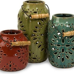Luna Ceramic Candle Lanterns - Set of 3 - A lace pattern combined with charming red, green, and blue finishes make the Luna Ceramic Candle Lanterns - Set of 3 a marvelous way to add style and color to your space. They're made of ceramic with iron handles, and each lantern includes a removable candle holder that's perfectly sized for one pillar candle (not included).About IMAXWhat began as a small company importing copper flower containers in 1984 by Al and Faye Bulak has developed into one of the top U.S. import companies serving the At Home market today. IMAX now provides home and garden accessories imported from twelve countries around the world, housed in a 500,000 square foot distribution center. Additional sourcing, product development and showroom facilities in the USA, India and China make IMAX a true global source. They're dedicated to providing products designed to meet your needs. This is achieved through a design and product development team that pushes creativity, taste and fashion trends - layering styles, periods, textures, and regions of the world - to create a visually delightful and meaningful environment. At IMAX, they believe style, integrity, and great design can make living easier.
