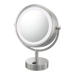 """NeoModern LED Lighted Mirror - Like its wall-hanging counterpart, the NeoModern LED Lighted Mirror is certain to brighten up any counter. With its 1x/5x magnification 9"""" diameter mirror, and standing only 13 ¾"""" tall, it can fit onto virtually any counter. The LED lighting is a low energy and virtually maintenance free. Available in four finishes."""