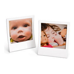 Retro Instant Photo Frames - I think these frames are fun and would really finish of a retro/eclectic office setup. Everyone wants pictures of the little babies at work but why not frame them in a way that's fun? I like the touch of the dry erase base so you can label them and change with the changing times.