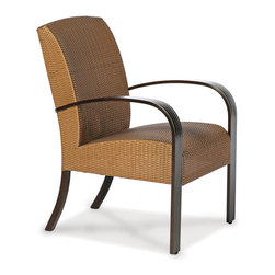 Thos. Baker - moderne dining armchair - Virtually an entire new category of outdoor furniture, moderne collection seating features premium, all-weather N-dura��_��__ wicker woven over reticulated (rapid water-shedding) foam.  The foam is sandwiched between the wicker and a powder-coated aluminum subframe providing comfort and support without the expense or inconvenience of separate cushions.