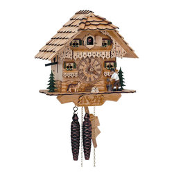 Schneider Cuckoo Clocks - 1-Day Black Forest House Cuckoo Clock in Natural Finish - Chalet style. 1-day rack strike movement. Wooden cuckoo, dial with roman numerals and hands. Individual handlaid wooden shingles. Moving wood chopper and dog at every full hour. Cuckoo calls and strikes every half and full hour. Shut-off lever on left side of case silences strike, call and music. Made from natural wood. Made in Germany. 10.2 in. W x 6.7 in. D x 10.2 in. H (5.7 lbs.). Care Instructions