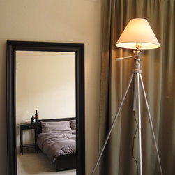 Tripod floor lamp - A mid-century brushed aluminum photographer's tripod converted into a large lamp. Suitable for floor lamp or desk lamp
