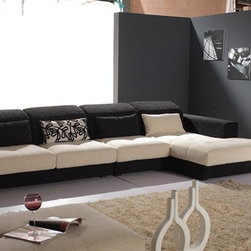 Currie Two-Toned Fabric Sectional - Bring a comfortable, stylish and versatile addition to your home decor with this Currie Two-Toned Fabric Sectional.