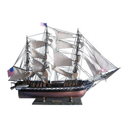 "Handcrafted Model Ships - USS Constitution Limited 38"" - Wooden Tall Ship Model - Sold Fully Assembled Ready for Immediate Display - Not a Model Ship kit. Finely-crafted details and museum-quality features define these Limited Edition scale replica tall ship models of the USS Constitution. Devoted attention to historical accuracy ensures that every detail on ""Old Ironsides"" matches the US Navy's oldest fighting tall ship as she still sails today. As the centerpiece of a den, office or meeting room, or perhaps setting a patriotic nautical tone for a family living room or corporate boardroom, this Limited Edition tall model ship is certain to inspire with her indomitable spirit and patriotic history. 38"" Long x 10"" Wide x 28"" High (1:64 scale)."