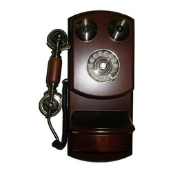 ORE International - Classic Wall Telephone in Mahogany Finish - Redial, hands free and tune switch. Slab base for keeping notepad or place notepad in small drawer underneath. Brass plated accents. Made from wood. 30 Days warranty. 9.5 in. W x 4.5 in. D x 15.75 in. H (5 lbs.)Escape from modern times with this European 1920's style wall phone. The artistic design is a conversation starter in more ways than one. Mount this beautiful piece on the wall and see how this nostalgic phone meshes old fashion practicality with modern times.