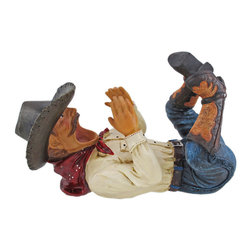 Western Vino Cowboy Wine Bottle Holder - This awesome imbibing cowboy bottle holder figurine is great for holding wine bottles, liquor bottles, or for holding olive oil as part of your kitchen decor. Made of cold cast resin, the holder stands 7 inches tall, is 11 inches long, and 6 inches wide. It adds a great accent to any Western decor.